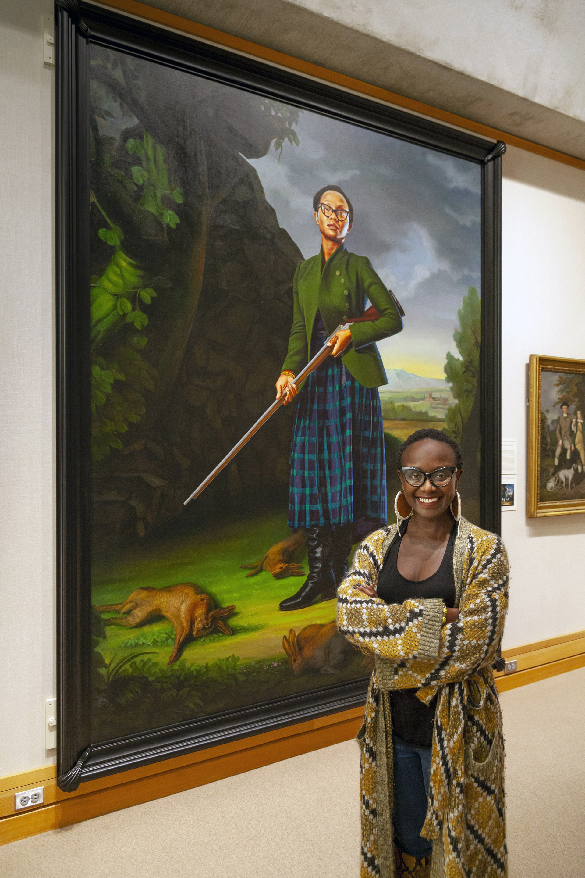 Lynette Yiadom-Boakye stands in front of her portrait by Kehinde Wiley, photo by Harold Shapiro