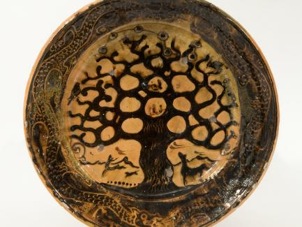 Bernard Leach, Charger, Tree of Life, 1923–25, earthenware, brown slip, and a galena glaze, The John Driscoll Collection, New York, photograph by Joshua Nefsky