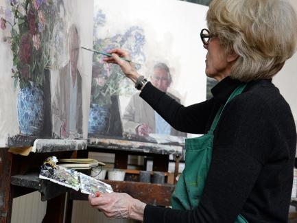 Eileen Hogan working on different versions of her portrait of HRH The Prince of Wales, 2016, photo by Sandra Lousada